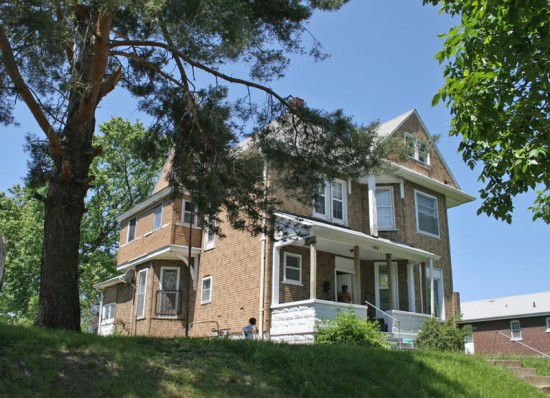A 2-story home built in 1900 must have stood by itself for a decade or so, as the homes next to it are younger. City records shwo this to be saved from the Land Redevelopment Authority in 1998. Excellent!