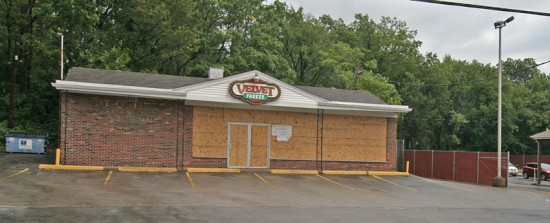 "A week after Mike Brown's death by a Ferguson cop on August 9, 2014, the Velvet Freeze was boarded up. The paper sign read: ""Stay Strong, God Is In Charge, We'll Be Back Soon."""